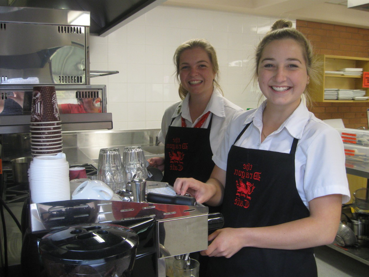 two students using barista machines